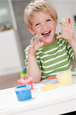 finger painting - young boy playing with colours Stock Photo - Premium Royalty-Free, Code: 649-03295972