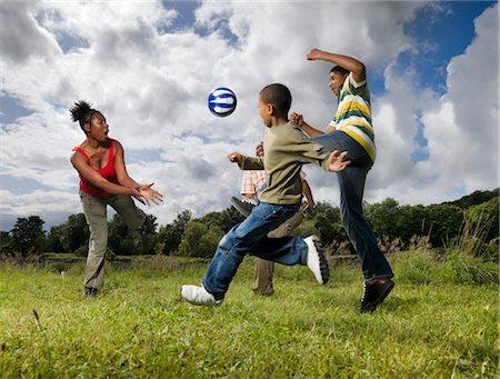 family playing football Stock Photo - Premium Royalty-Free, Code: 649-03296039