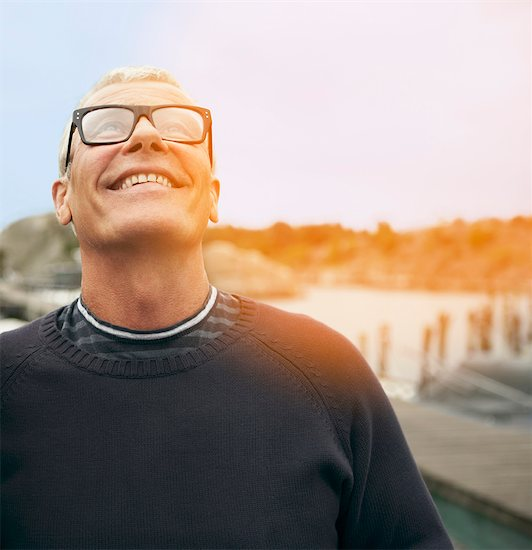 Middle aged man, portrait with flare Stock Photo - Premium Royalty-Free, Image code: 649-03296507