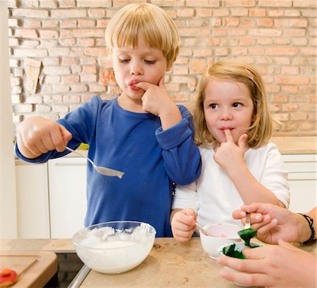 preteen girl licking - girl, boy tasting baking ingredients Stock Photo - Premium Royalty-Free, Code: 649-03296628