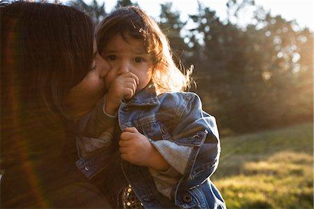 Mother hugging daughter Stock Photo - Premium Royalty-Free, Code: 649-03297546