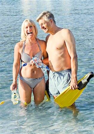Senior couple with snorkels in the sea Stock Photo - Premium Royalty-Free, Code: 649-03291881
