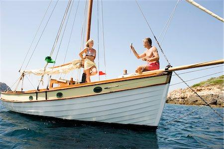 seniors woman in swimsuit - A senior couple sailing Stock Photo - Premium Royalty-Free, Code: 649-03291890