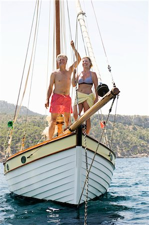 seniors woman in swimsuit - A senior couple sailing Stock Photo - Premium Royalty-Free, Code: 649-03291891