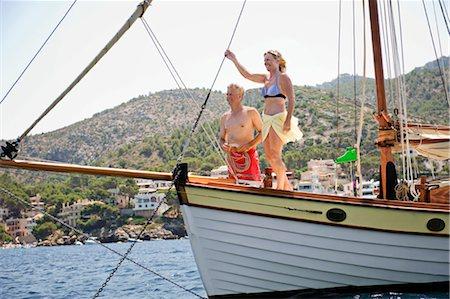 seniors woman in swimsuit - A senior couple sailing Stock Photo - Premium Royalty-Free, Code: 649-03291892