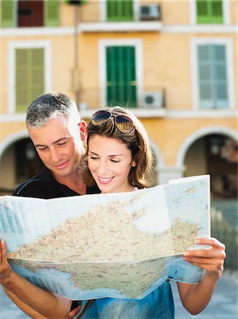couple looking at a map Stock Photo - Premium Royalty-Free, Code: 649-03292025