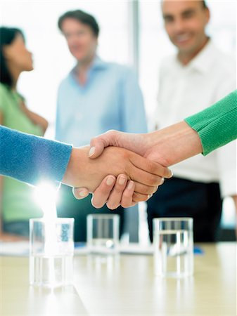 Closing a business deal by shaking hands Stock Photo - Premium Royalty-Free, Code: 649-03292187