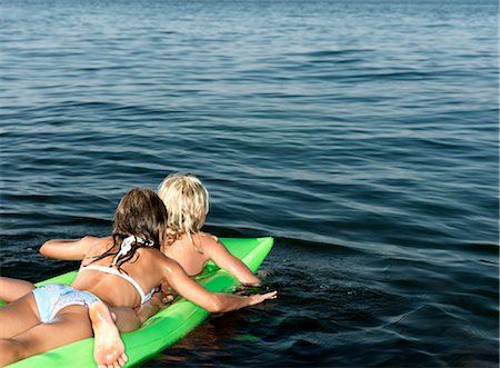 Girls on inflatable mattress Stock Photo - Premium Royalty-Free, Code: 649-03292874