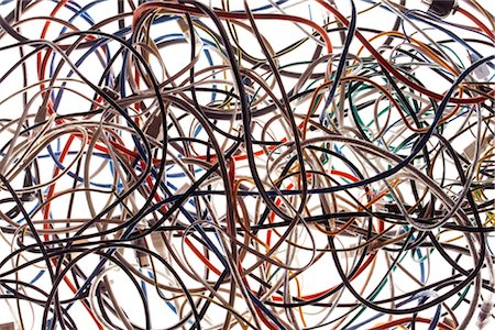A tangle of colored wires on the ground Stock Photo - Premium Royalty-Free, Code: 649-03293620