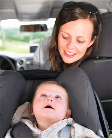 mother watching baby in car seat Stock Photo - Premium Royalty-Free, Code: 649-03293749