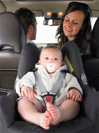 mother watching baby in car seat Stock Photo - Premium Royalty-Free, Code: 649-03293750