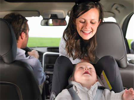 mother watching baby in car seat Stock Photo - Premium Royalty-Free, Code: 649-03293751