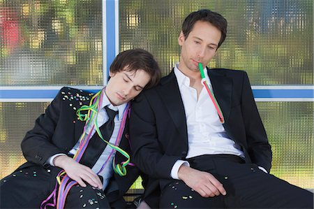 drunk passed out - two businessmen at bus stop after party Stock Photo - Premium Royalty-Free, Code: 649-03363048