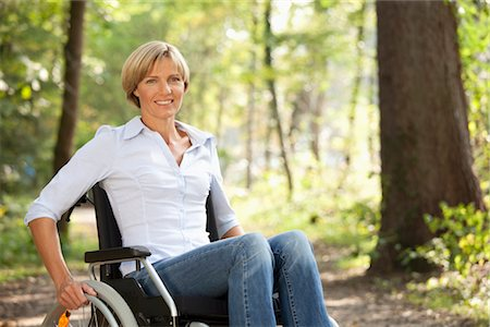 Middle aged woman in a wheelchair Stock Photo - Premium Royalty-Free, Code: 649-03363299