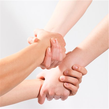2 pair of hands holding each other Stock Photo - Premium Royalty-Free, Code: 649-03417585