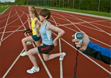 stop watch - 3 female athletes and trainer Stock Photo - Premium Royalty-Free, Code: 649-03417685