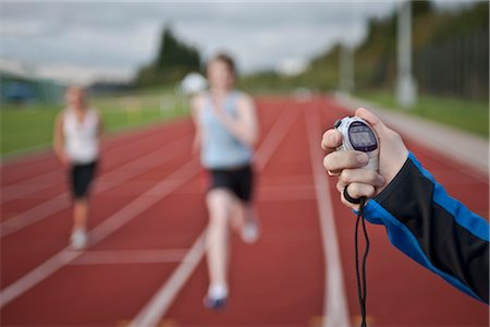 stop watch - 2 female athletes and stopwatch Stock Photo - Premium Royalty-Free, Code: 649-03417693