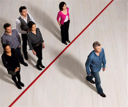 Business men and women crossing red line Stock Photo - Premium Royalty-Free, Code: 649-03446878