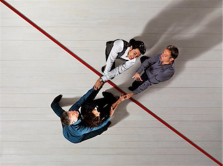 Business people pulling each other Stock Photo - Premium Royalty-Free, Code: 649-03446904