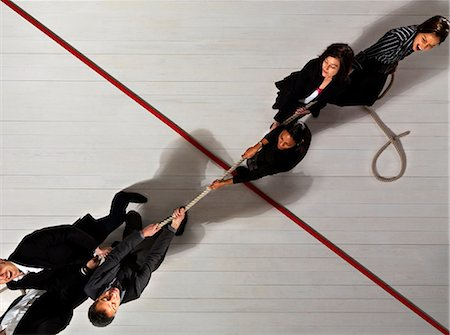 Business people pulling each other Stock Photo - Premium Royalty-Free, Code: 649-03446908