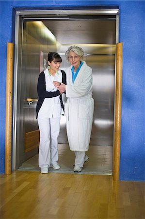 patient walking hospital halls - Old woman and nurse Stock Photo - Premium Royalty-Free, Code: 649-03447152