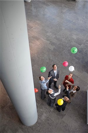release - Business team sets colored balloons free Stock Photo - Premium Royalty-Free, Code: 649-03447438