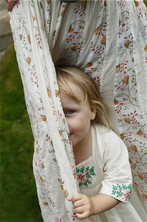 shy baby - Little girl hiding behind curtains Stock Photo - Premium Royalty-Free, Code: 649-03447742
