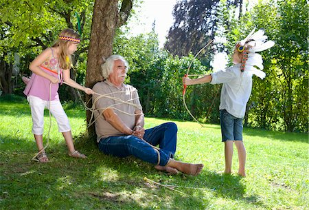 restrained - Grandchildren got their grandfather tied Stock Photo - Premium Royalty-Free, Code: 649-03448398