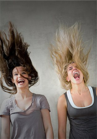 Teen girls laughing together Stock Photo - Premium Royalty-Free, Code: 649-03465358