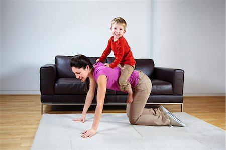 Mother giving boy a piggyback ride Stock Photo - Premium Royalty-Free, Code: 649-03465795