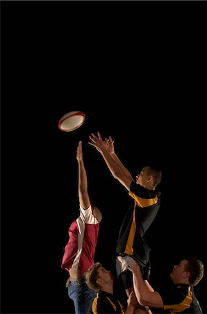 Rugby players jumping for ball Stock Photo - Premium Royalty-Free, Code: 649-03466224