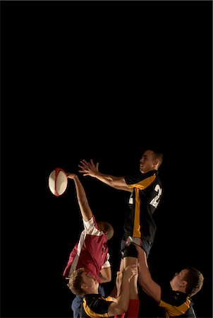 Rugby players competing for ball in air Stock Photo - Premium Royalty-Free, Code: 649-03466225