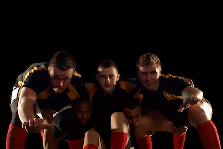 Rugby players in scrum formation Stock Photo - Premium Royalty-Free, Code: 649-03466228