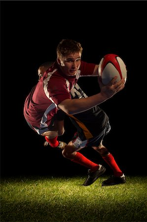 scoring - Rugby player being tackled and scoring Stock Photo - Premium Royalty-Free, Code: 649-03466230