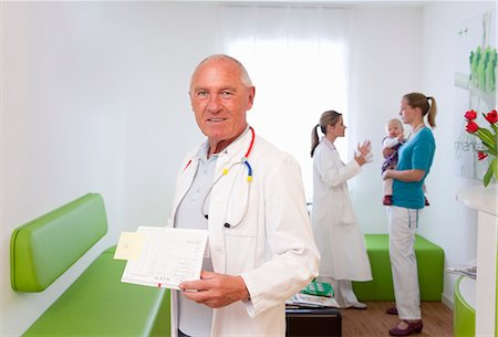 doctor in waiting room - Doctor in surgery Stock Photo - Premium Royalty-Free, Code: 649-03487228