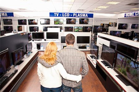 plasma - Young Couple in TV section Stock Photo - Premium Royalty-Free, Code: 649-03487398
