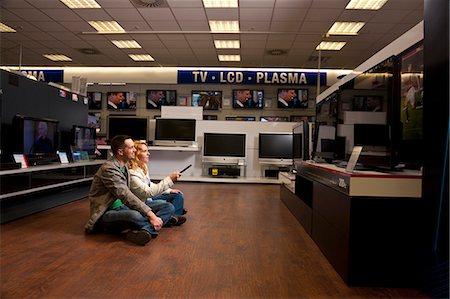 plasma - Young couple checking TV Stock Photo - Premium Royalty-Free, Code: 649-03487399