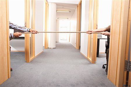 Tug of war in the office Stock Photo - Premium Royalty-Free, Code: 649-03487433