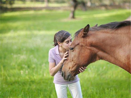 preteen kissing - Girl kissing horse on forehead Stock Photo - Premium Royalty-Free, Code: 649-03487593