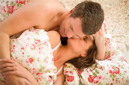 Woman and man in bed Stock Photo - Premium Royalty-Free, Code: 649-03510780