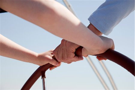 Man and boy steering yacht Stock Photo - Premium Royalty-Free, Code: 649-03510960