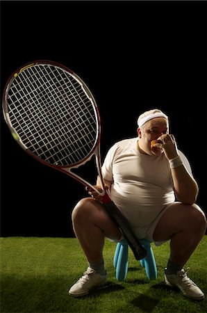 fat man exercising - Tennis player with large racquet sitting Stock Photo - Premium Royalty-Free, Code: 649-03511270