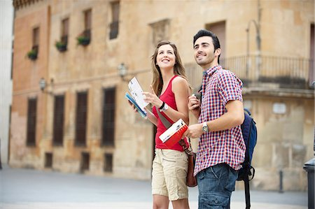 Couple with guidebooks in city square Stock Photo - Premium Royalty-Free, Code: 649-03566314