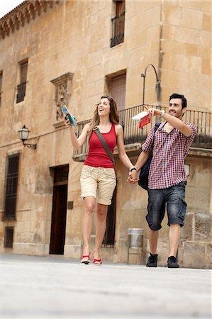 Tourist couple exploring town square Stock Photo - Premium Royalty-Free, Code: 649-03566320