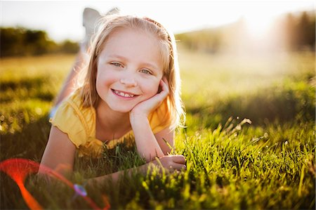 preteen  smile  one  alone - Young girl in grass smiling Stock Photo - Premium Royalty-Free, Code: 649-03566642