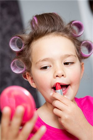 Little Girl using lipstick Stock Photo - Premium Royalty-Free, Code: 649-03566889