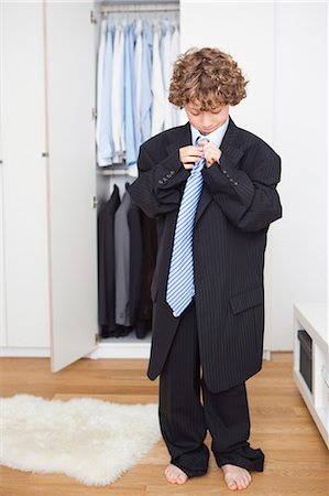 Boy in fathers suit Stock Photo - Premium Royalty-Free, Code: 649-03566892