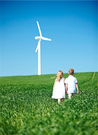 Boy and girl lookng at wind turbine Stock Photo - Premium Royalty-Free, Code: 649-03621502
