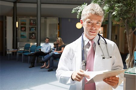doctor in waiting room - Doctor and patients in waiting area Stock Photo - Premium Royalty-Free, Code: 649-03621602