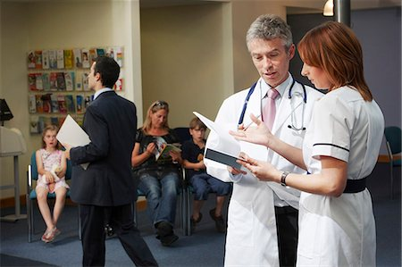 simsearch:6113-07146726,k - Doctor and nurse in waiting area Stock Photo - Premium Royalty-Free, Code: 649-03621618